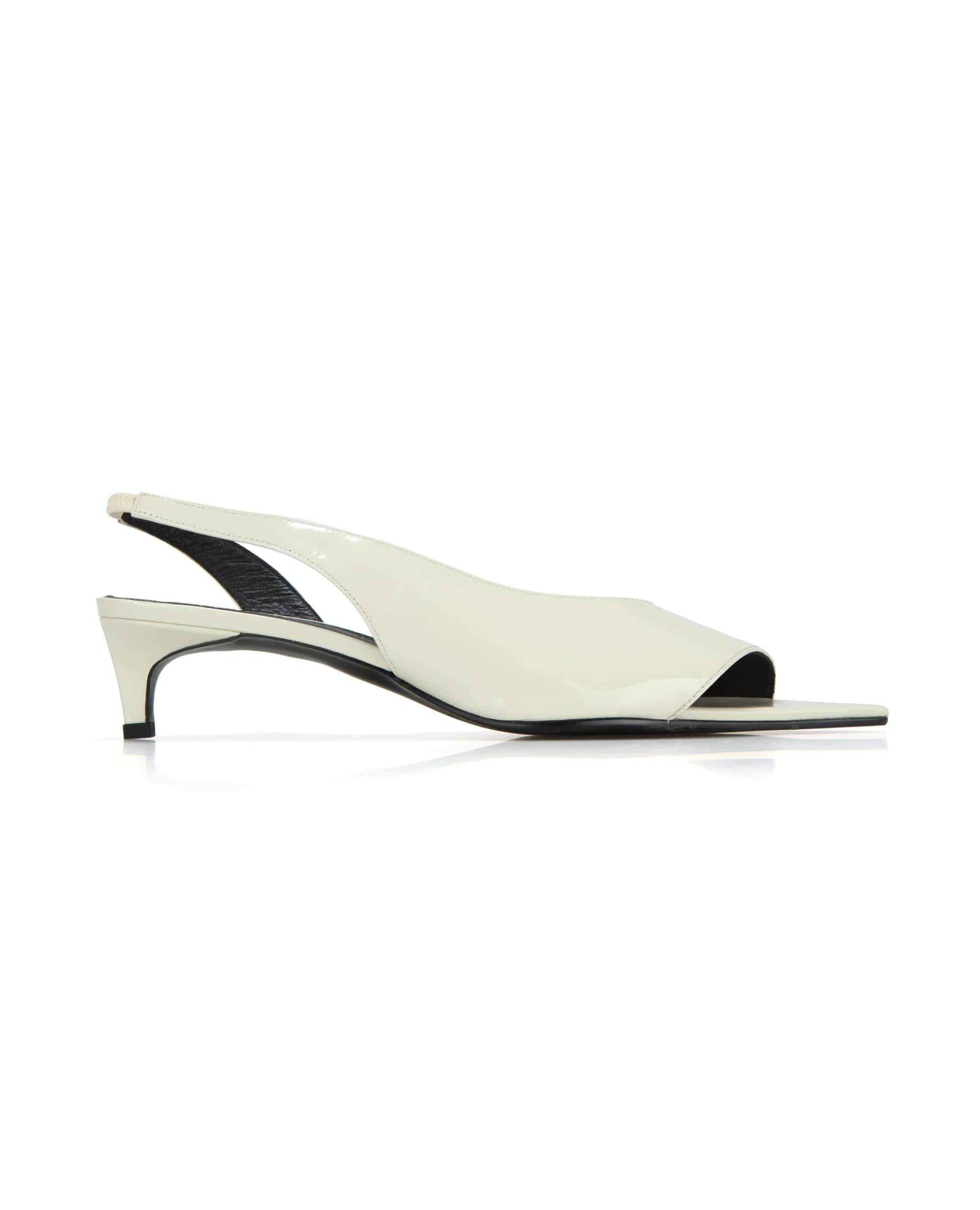 Extreme sharp toe diagonal lined slingbacks | Glossy butter