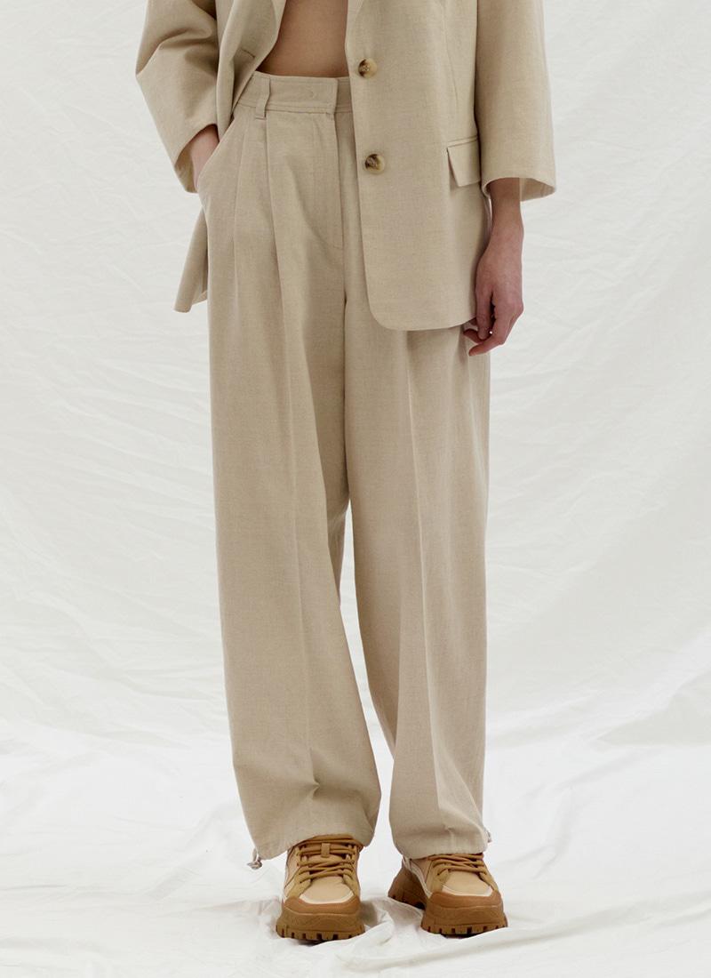 STRING POINT TUCK PANTS - BEIGE