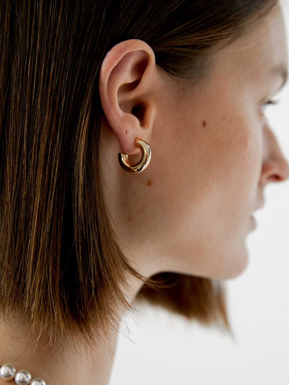 curving earring - gold