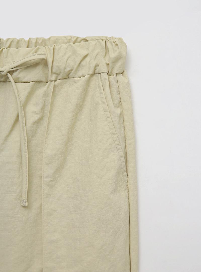 開衩襬腰抽繩純色縮口褲
