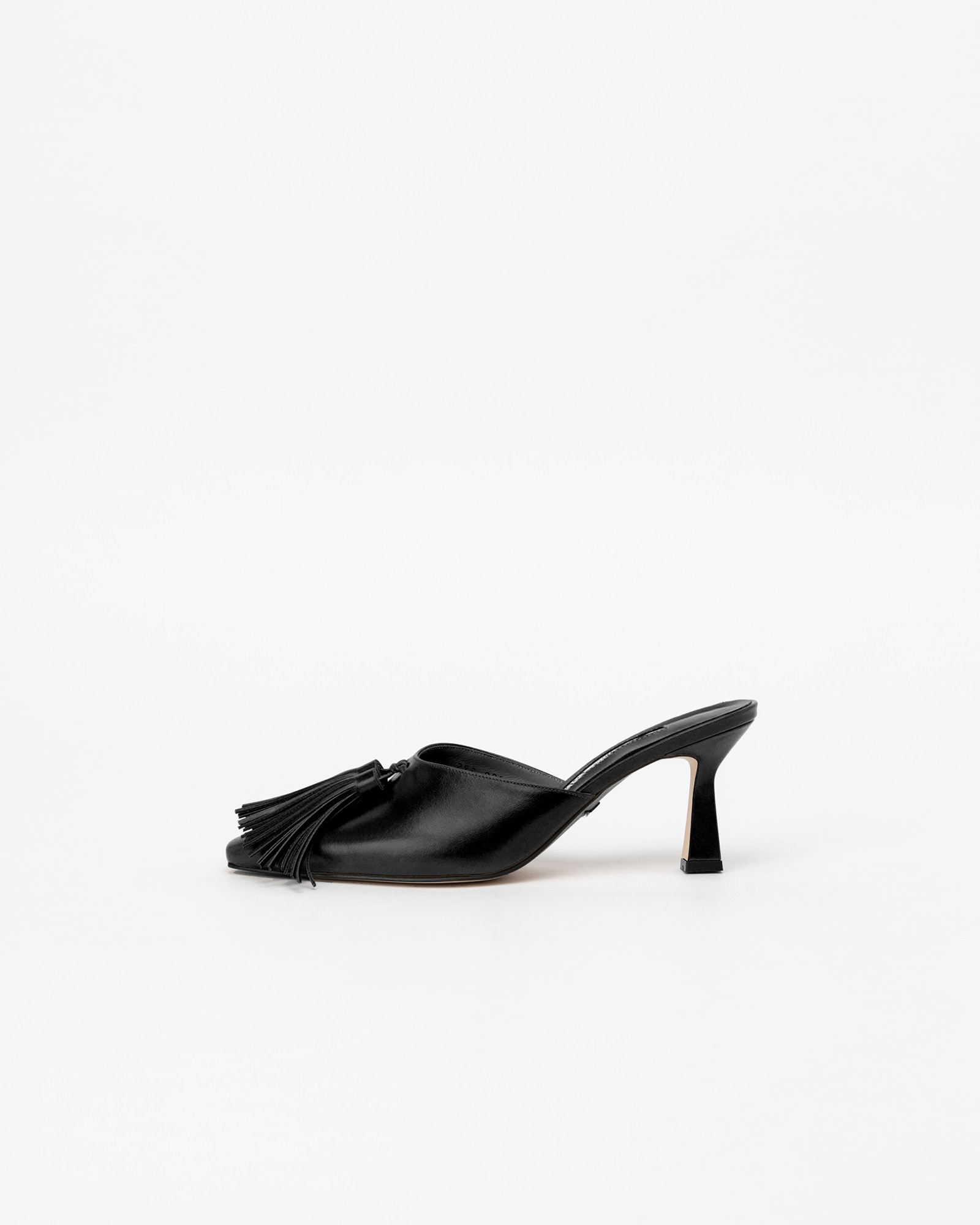 Emila Tassel Mules in Textured Black
