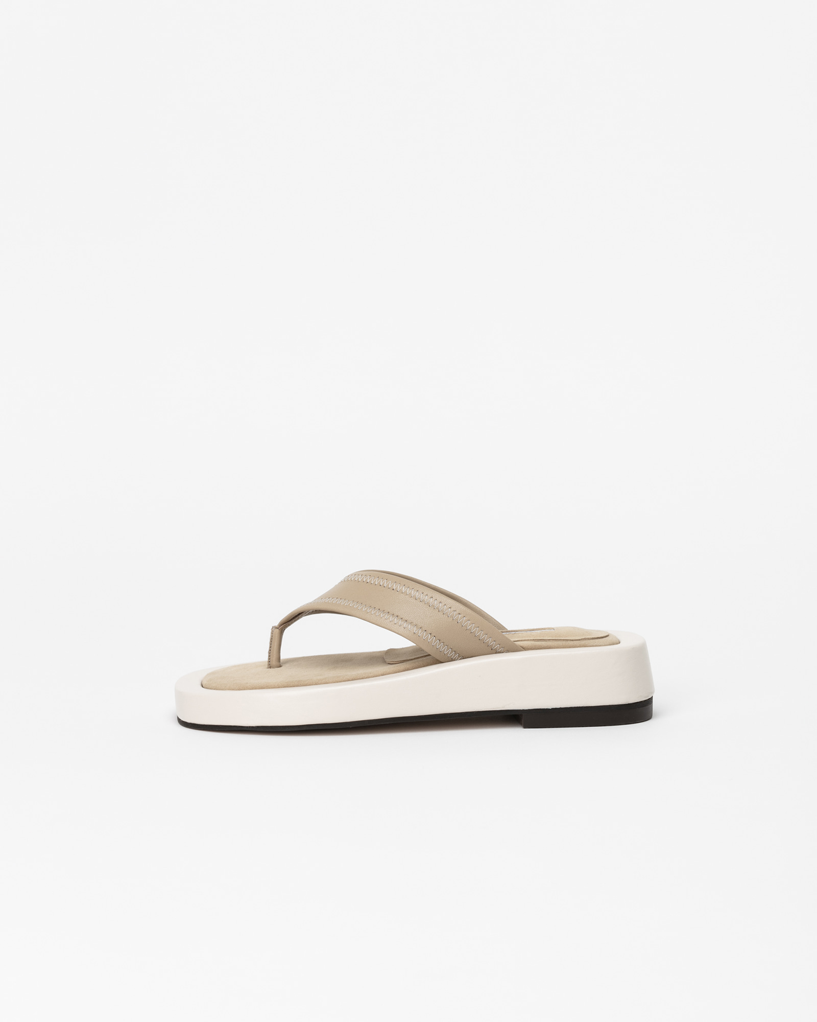 Alpensia Footbed Thong Slides in Ivory and Beige