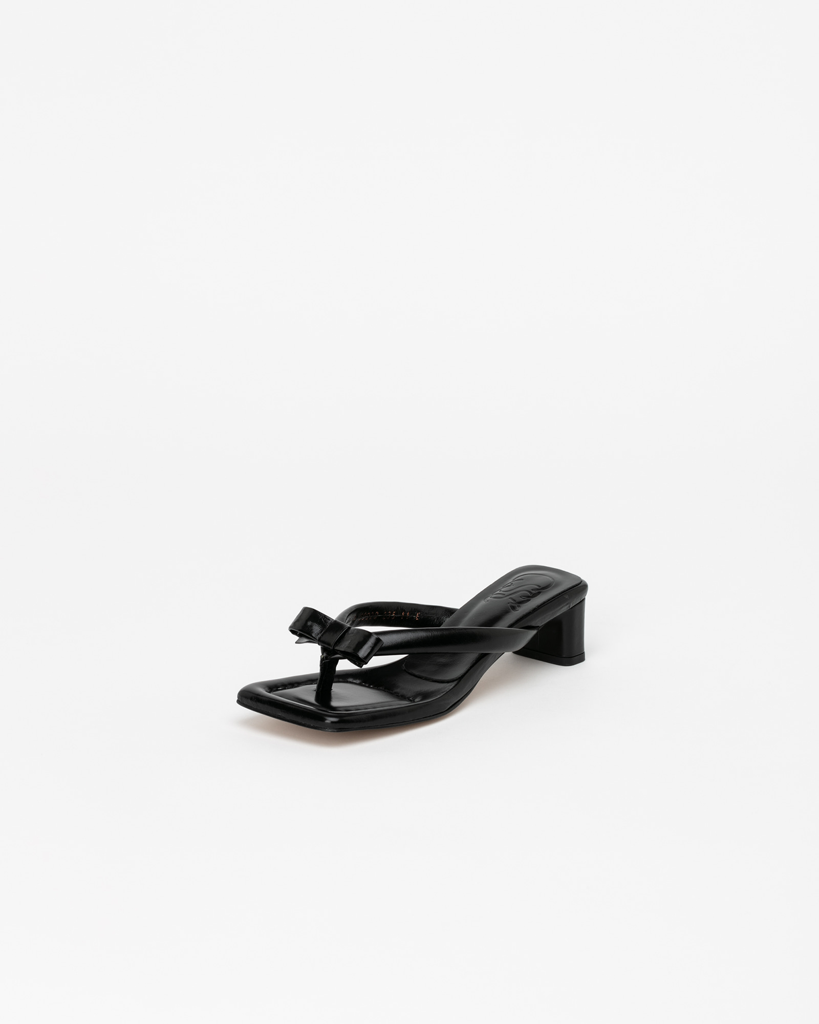 Fosette Thong Mules in Textured Black