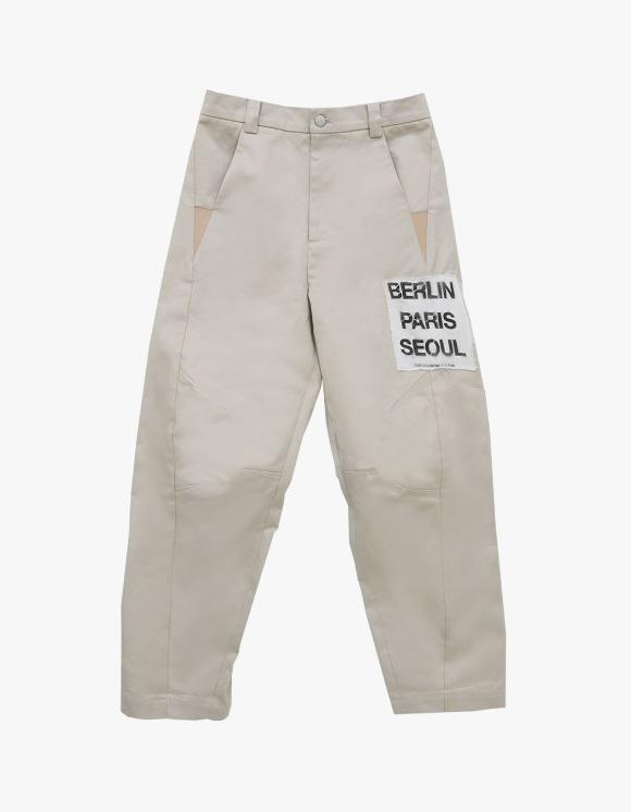 The Museum Visitor Paris / Berlin / Seoul Patch Wide Pants - Beige | HEIGHTS. | 하이츠 온라인 스토어