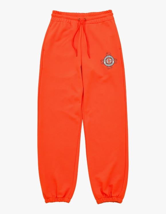 NIVELCRACK NB Crest Sweatpants - Orange   HEIGHTS.   하이츠 온라인 스토어
